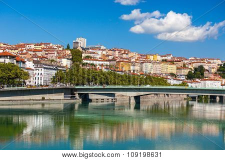 Cityscape Of Lyon, France With Reflections In The Water