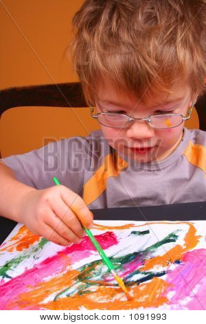 Young Boy Covered In Bright Paint With Paint
