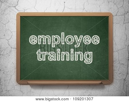 Learning concept: Employee Training on chalkboard background