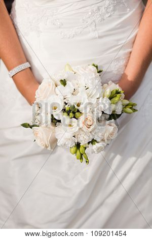 Close up of bride with wedding bouquet