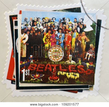 stamp printed in Great Britain showing an image of The Beatles Sgt. Peppers Lonely Hearts Club Band