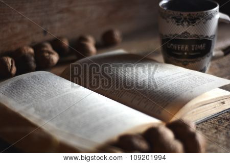 Book On Wood Table With Coffee.