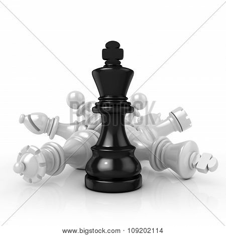 Black king standing over fallen black chess pieces