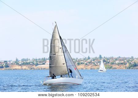 Sailing yacht on river
