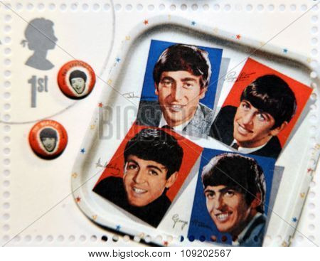 A stamp printed in Great Britain shows the Beatles memorabilia