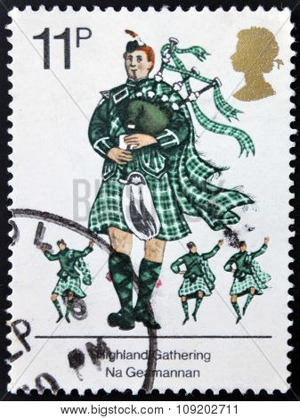 A stamp printed in Great Britain dedicated to British Cultural Traditions shows England Gathering