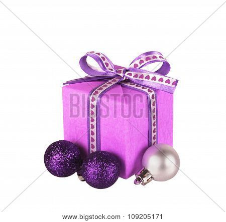 violet gift box with ribbon bow and christmas balls