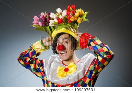 Clown with tulip flowers in funny concept