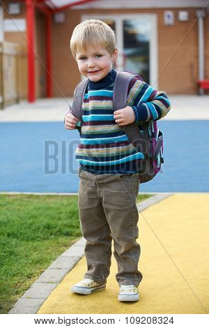 Little Boy Going To School Wearing Backpack