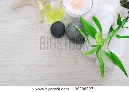 Beautiful composition of spa treatment on wooden table