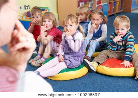 Group Of Children Copying Teacher In Montessori/pre-school Class