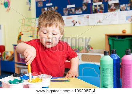 Male Pre School Pupil In Art Lesson