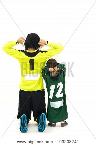 Woman Goalkepper And Her Little Fan In Studio Showing Their Numbers