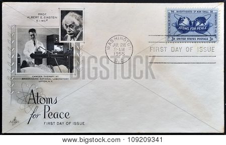 a stamp printed in USA shows Atomic Energy Encircling the Hemispheres Atoms for Peace