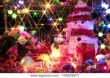 Snowman And A Decorated Christmas Tree With Light