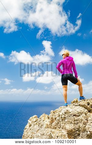 Accomplished runner climber or hiker business concept. Woman trail runner looking at beautiful view