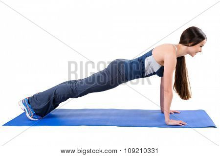 Young woman shows Straight Arms Plank Workout, isolated on white, side view