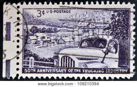 A Stamp printed in USA shows the Truck Farm and Distant City Trucking Industry 50th anniversary