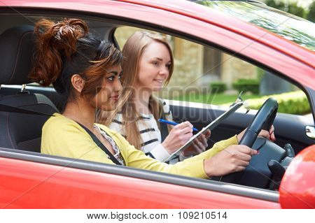 Young Woman Having Driving Lesson With Female Instructor