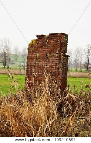 Wall Ruins In A Field