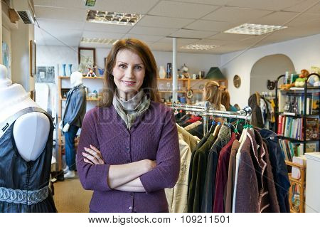 Portrait Of Volunteer Working In Charity Shop