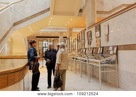 ST. PETERSBURG, RUSSIA - SEPTEMBER 18, 2015: Chief bibliographer of Institute of History Elena Panchenko talks with visitors of exhibition Book And Manuscript Collection Of Academician N. P. Likhachev
