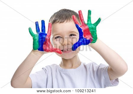 Portrait of little boy with paints on hands isolated on white background