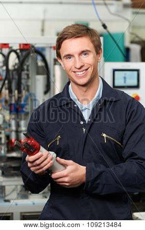 Engineer Holding Component In Factory
