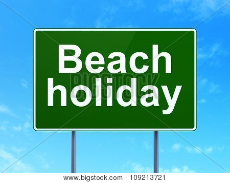 Travel concept: Beach Holiday on road sign background