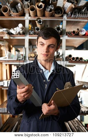 Factory Worker In Store Room With Components