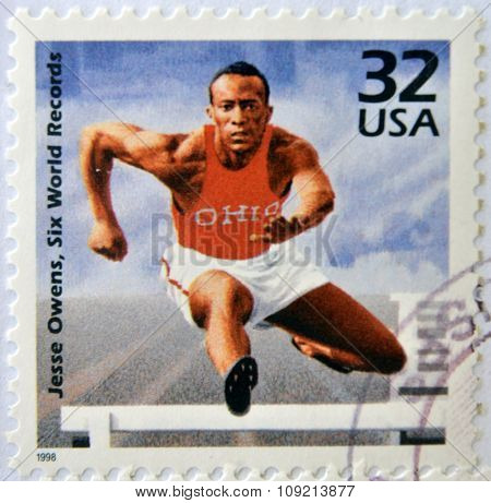 A stamp printed in USA showing an image of Jesse Owens six world records circa 1998.