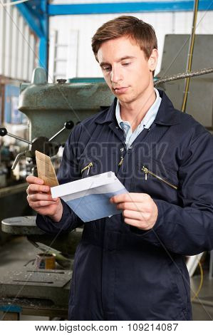 Factory Worker Opening Wage Packet