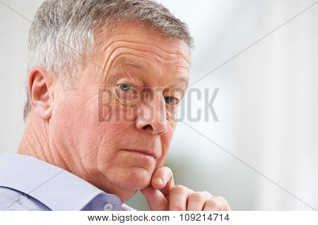 Portrait Of Thoughful Senior Man At Home
