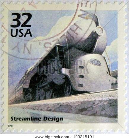 a stamp printed in USA showing an image of a train with streamline design circa 1998.