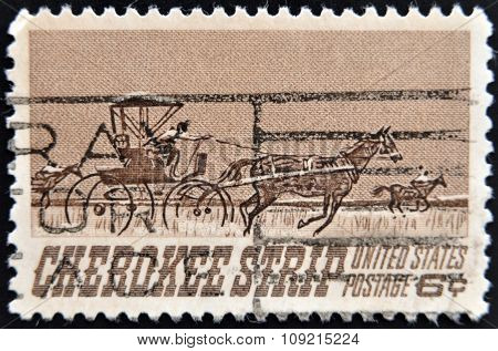 a stamp printed in USA shows Homesteaders Racing to Cherokee Strip
