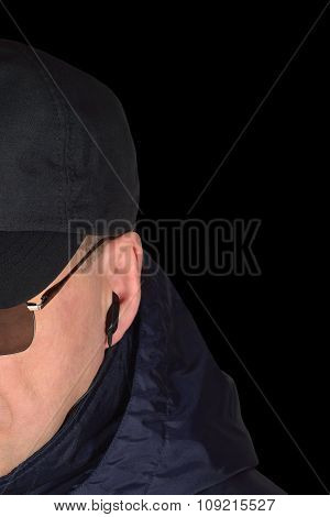 Police security guard specops staff policeman covertly listening, isolated portrait, covert agent