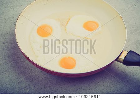 Vintage Photo Of Fried Eggs In The White Pan