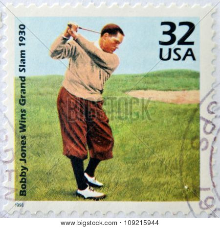 A stamp printed in USA showing an image of Bobby Jones wins grand slam 1930 circa 1998.