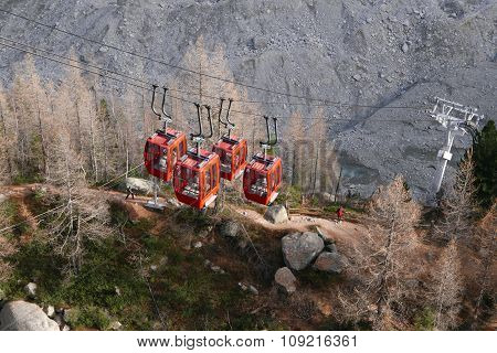 Four red cable-cars