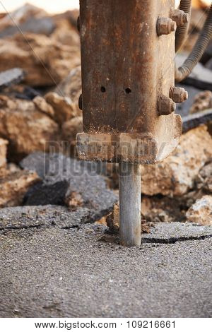 Close Up Of Road Being Dug Up For Repair