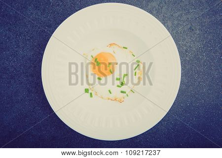 Vintage Photo Of Fried Egg With Chives On White Plate