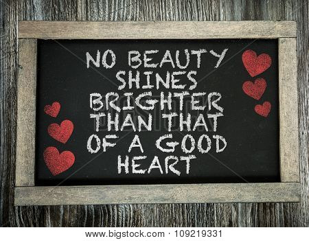 No Beauty Shines Brighter Than That a Good Heart written on chalkboard