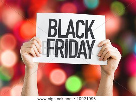 Black Friday placard with red lights on background