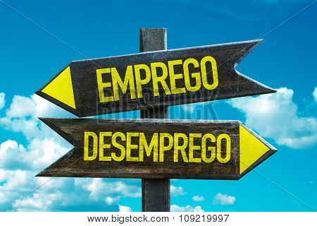 Employment - Unemployment (in Portuguese) signpost with sky background