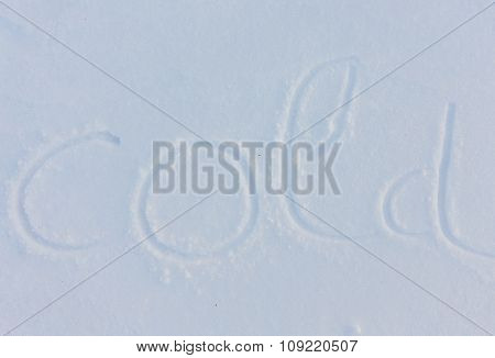 The word cold written on snow background