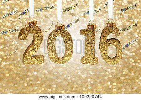 2016 numbers hanging from ribbon with twinkling gold background