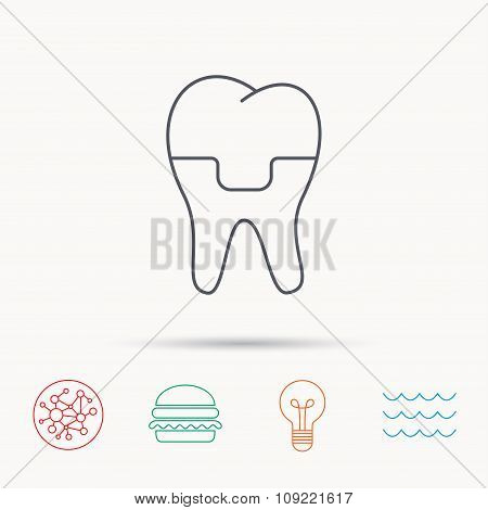 Dental crown icon. Tooth prosthesis sign.