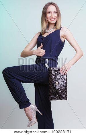 Fashion Woman With Handbag Giving Thumb Up Gesture