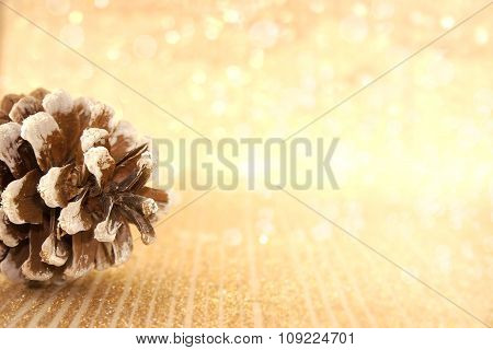Pinecone On Golden Shiny Background With Copy Space For Text. Holiday Background Or Greeting Card. S