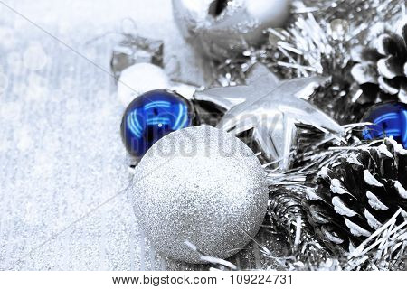Silver Christmas Decorations On Shiny Background With Copy Space For Text. Christmas Background Or G